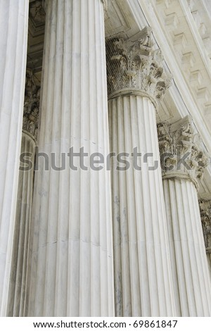 The rows of classical columns with portico. Supreme court building in Washington, DC
