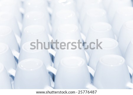 the rows of white porcelain cups, close-up