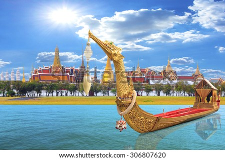 The Royal Barge Suphannahong parades past the Grand Palace at the Chao Phraya River during Fry the Kathina ceremony cloth of Royal Barge Procession in Bangkok, Thailand. - stock photo