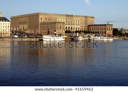 The royal castle in Stockholm, Sweden. Early morning light and reflections in calm water.