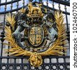 The royal crest on the gates of Buckingham Palace, London. - stock photo
