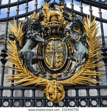 The royal crest on the gates of Buckingham Palace, London.