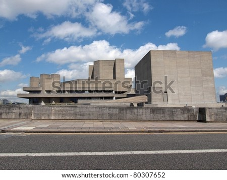 The Royal National Theatre theater in London England UK United Kindgom new brutalist concret Brutalism architecture over blue sky with clouds