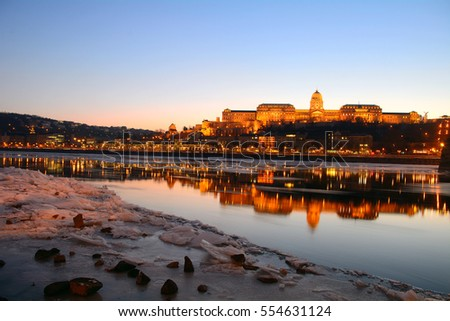 The Royal Palace at sunset over the icy Danube River, Budapest, Hungary