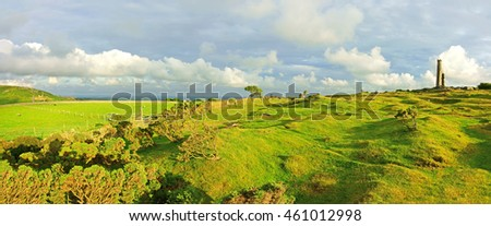 The rugged beauty of Bodmin Moor and late evening sun light over a distant view of the ruins of Craddock Moor engine house, Cornwall, England, UK