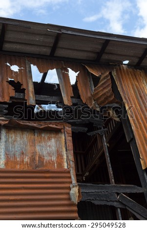 The ruin of a wooden house after burnt down by fire. - stock photo