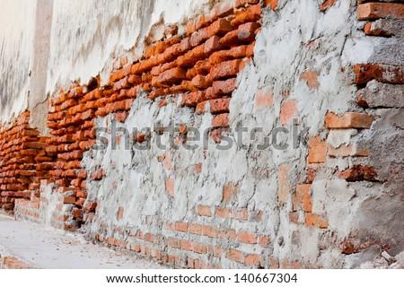The ruin wall brick on renovation. - stock photo