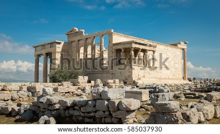 The ruins and stone carvings of the Erechtheion temple at the Acropolis, Athens, part of the citadel overlooking the city below