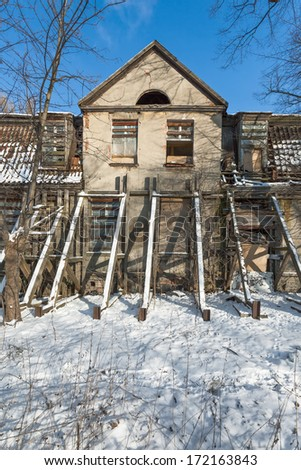 The ruins of an old mansion and lying snow