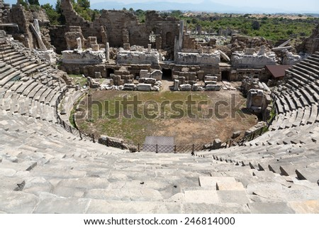 The ruins of  ancient Roman amphitheatre in Side. Turkey - stock photo