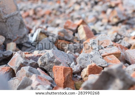 The ruins of bombed-out brick building. - stock photo