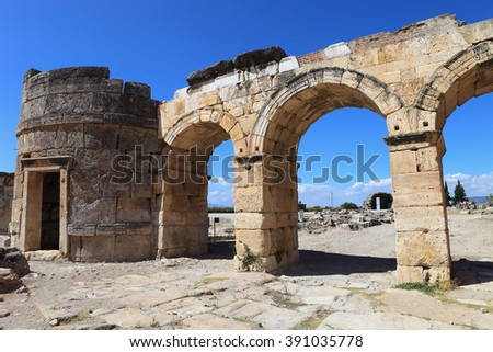the ruins of the ancient city of Hierapolis on the hill Pamukkale, Turkey. Symbol of broken civilisation - stock photo