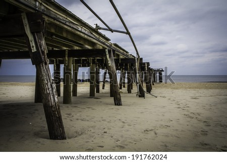 The ruins of the Ocean Grove Fishing Pier approximately three months after Hurricane Sandy destroyed the New Jersey coastline.  - stock photo