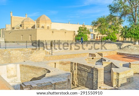 The ruins of the old bazaar with the the oldest in town Magoki-Attari mosque on the background, Bukhara, Uzbekistan. - stock photo