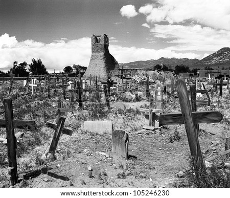 The ruins of the original San Geronimo mission church in a cemetery of wooden grave markers. The church was destroyed by the US army during a revolt in 1847. (Scanned from black and white film.) - stock photo