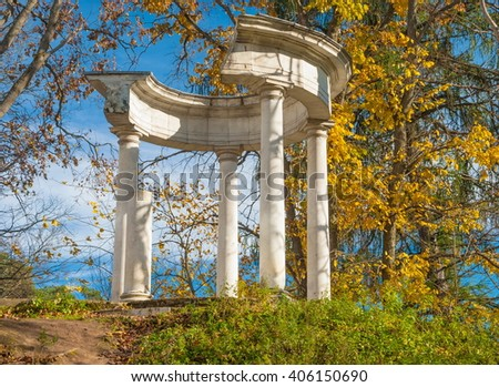 The ruins of the rotunda in the autumn park - stock photo