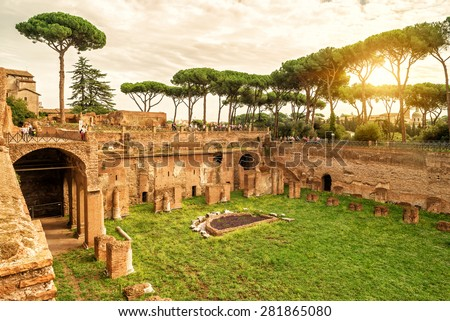 The ruins of the stadium of Domitian on the Palatine Hill at sunset in Rome, Italy - stock photo