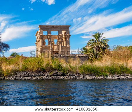 The ruins of the Temple of Isis in a blur foreground, Aswan, Egypt - stock photo