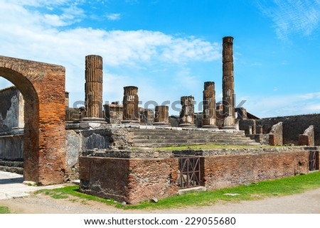 The ruins of the Temple of Jupiter Pompeii, Italy. Pompeii is an ancient Roman city died from the eruption of Mount Vesuvius in 79 AD. - stock photo