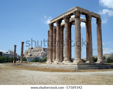 The ruins of the Temple of Zeus with the Acropolis in the background in Athens, Greece.