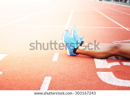 the runner athletes stretching on racing track