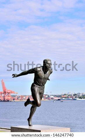 The runner statue in front of Canada Place - stock photo