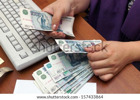 The Russian banknotes in hands - stock photo