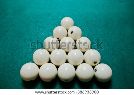 The russian billiards balls on the table