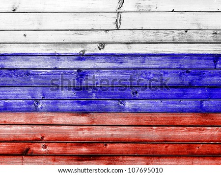 The Russian flag painted on wooden fence - stock photo