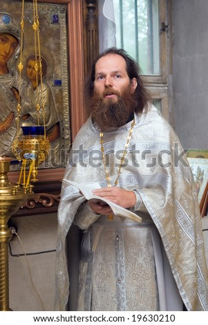 The Russian orthodox priest in a temple - stock photo