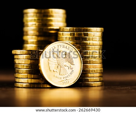 The Russian rouble coin and gold money on the desk - stock photo
