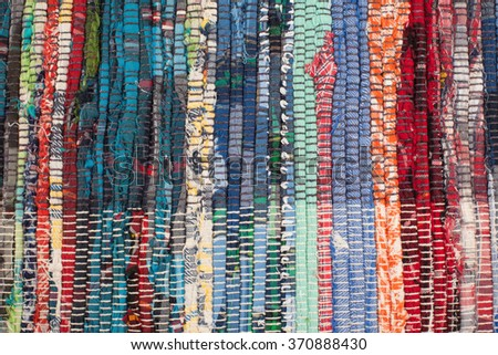 The rustic style. Grandmother's rug. Colored woven texture. Colorful background