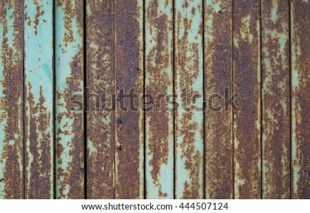 The rusty steel door background. - stock photo