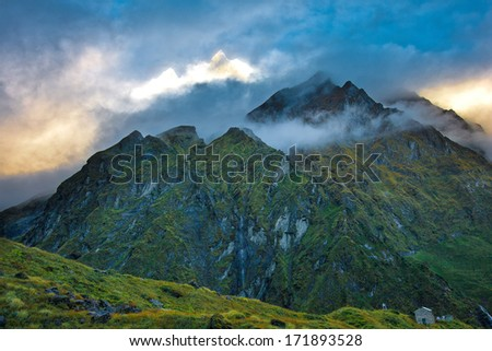 The Sacred Fishtail Mountian (Machhapuchre) seen in the distance, sunrise, in Annapurna Range, Nepal - stock photo