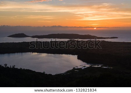The sacred lake and the sea, view of Mont Passot, the highest point on Nosy Be island, northern Madagascar - stock photo