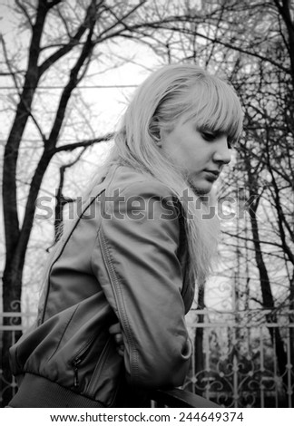 The sad girl in the park - stock photo