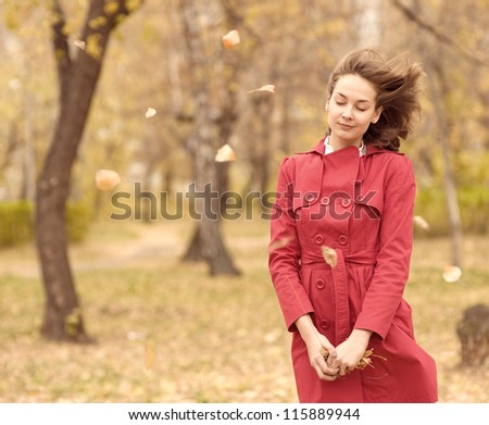 the sad teenager in autumn park - stock photo