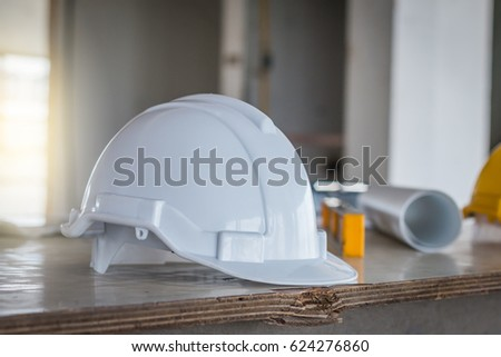 Safety helmet blueprint on table construction stock photo royalty the safety helmet and the blueprint on table at construction site malvernweather Images