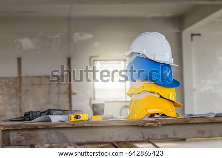 Safety helmet blueprint on table construction stock photo 642865423 the safety helmet and the blueprint on table at construction site malvernweather Images