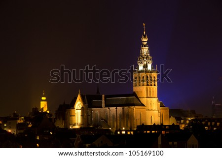 The Saint Steven's Church in the historic city centre of Nijmegen by the river the Waal. - stock photo