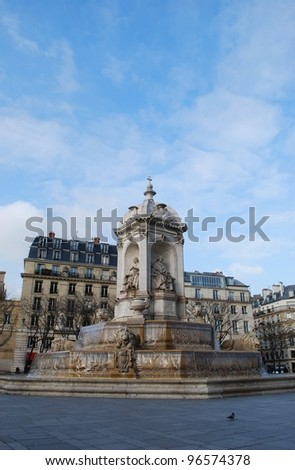 The Saint Sulpice fountain in the square in front of the famous church, Paris, France - stock photo