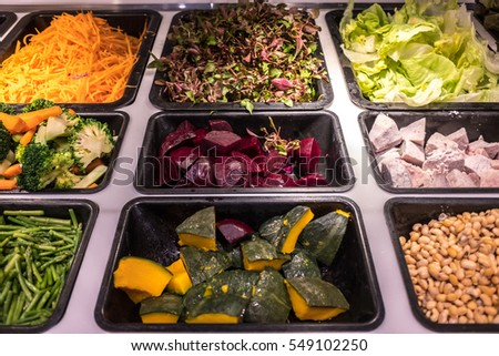 The salad bar with choices of vegetables