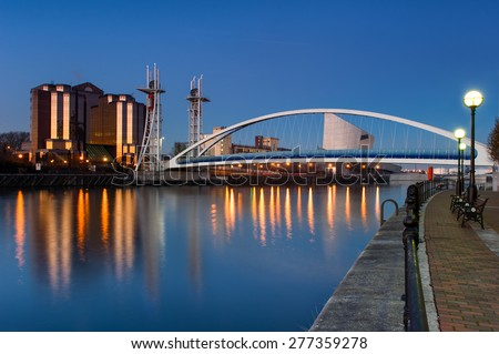 The Salford Quays lift bridge, also known as Salford Quays Millennium footbridge, in Manchester, England. - stock photo