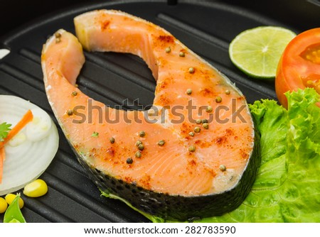 The salmon fish on a pan for design or decorate project. - stock photo