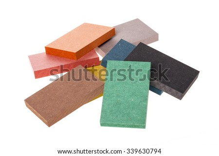 The sample of the colorful valchromat(eco-wood board), brown, green, black, blue, orange, grey, red, yellow for ecological interior, nature isolated white. - stock photo