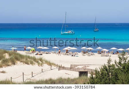 The sand and the blue waters of Cala Saona beach, Formentera, Spain - stock photo