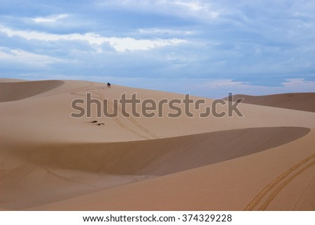 The sand dune and weather storm background ,using filter