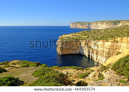 The sandstone cliffs at Xlendi bay on the Island of Gozo, Malta.
