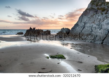The sandy and rock beach at Freathy on the south east coast of Cornwall - stock photo