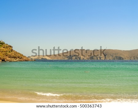 The sandy Ftelia beach under the blue sky and turquoise sea on summer season in Mykonos, Greece